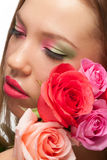 Woman with makeup and roses Royalty Free Stock Images