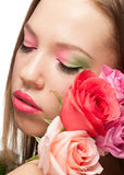 Woman with makeup and roses Stock Image