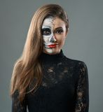 Woman with makeup skeleton grins Stock Images