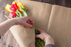 Woman makind bouquet of tulips Royalty Free Stock Photo