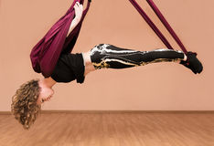 Woman making aerial yoga exercises Royalty Free Stock Photography