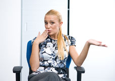Woman making apologising expression Royalty Free Stock Photography