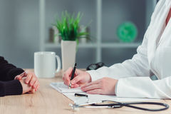 Woman making appointment for medical exam at general practitioner office stock image