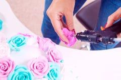 Woman making artificial rose Stock Photos