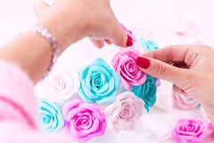 Woman making artificial rose stock photography