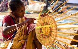 Woman making basket Stock Images