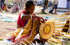 Woman making basket in a fair. Woman making a bamboo basket in a fair Royalty Free Stock Photos