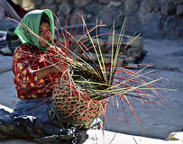 Woman Making a Basket, Mexico. Tarahumara woman, of the indigenous native  people in the Copper Canyon of the Sierra Madre mountains, in Mexico, weaves a basket Stock Images