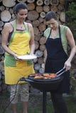 Woman making BBQ stock image