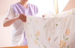 Woman making bed Royalty Free Stock Photo