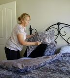 Woman Making Bed Royalty Free Stock Photos