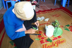 Woman making betel with betel and areca Stock Photo