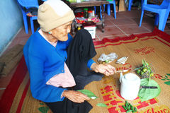Woman making betel with betel and areca Royalty Free Stock Photo