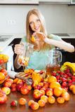 Woman making beverages from fruits Stock Photos