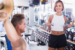 Woman making biceps curls Stock Photography