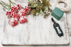 Woman making bouquet of red and white carnation flowers Royalty Free Stock Images