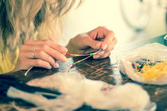 Woman making bracelet at home, hobby Royalty Free Stock Image