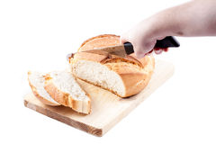 A woman is making bread slices Royalty Free Stock Photos