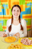 Woman is making breaded squid rings Stock Photography