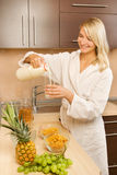 Woman making breakfast Royalty Free Stock Photos