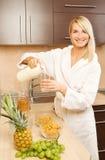 Woman making breakfast Stock Image