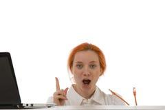 Woman making a breakthrough Stock Photo