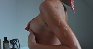 Breast cancer awareness, self exam. Woman is making breast self exam looking for breast cancer signs stock video footage