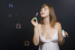 Woman making bubbles Stock Images