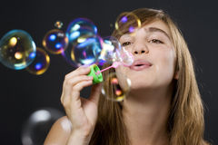 Woman making bubbles Stock Image