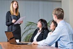 Woman making a business presentation Stock Photos