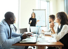 Woman making a business presentation to group. Woman making a business presentation to a group Royalty Free Stock Photography