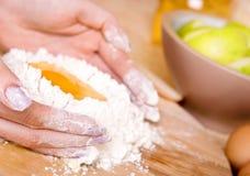 Woman making cake. Woman making apple cake close up Royalty Free Stock Image