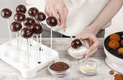 Woman making cake pops Stock Images