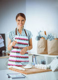 Woman is making cakes in the kitchen Royalty Free Stock Images