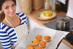 Woman is making cakes in the kitchen Royalty Free Stock Image