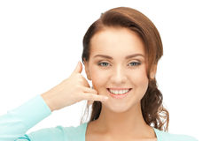 Woman making a call me gesture Stock Images