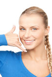 Woman making a call me gesture Royalty Free Stock Image