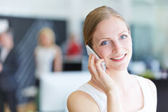 Woman making calls with smartphone Stock Photography