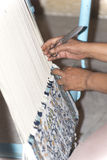 Woman making carpet Royalty Free Stock Photos