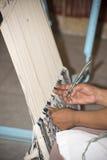 Woman making carpet Royalty Free Stock Photo