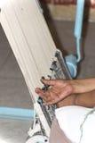 Woman making carpet Stock Photos