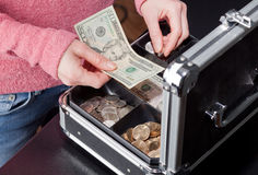 Woman making change from a cashbox Stock Photo
