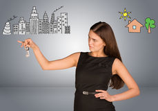 Woman making choice between city and country Royalty Free Stock Photography