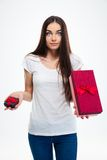 Woman making choice between two gift boxes. Young pretty woman making choice between two gift boxes isolated on a white background Stock Photography