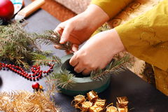 Woman making christmas advent wreath royalty free stock photo