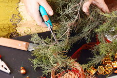 Woman making christmas advent wreath Stock Photo