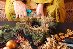 Woman making christmas advent wreath Stock Images