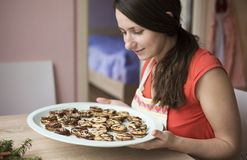Woman is making christmas cakes Stock Image