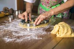 Woman making Christmas cookies Stock Images