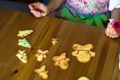 Woman making Christmas cookies Stock Image